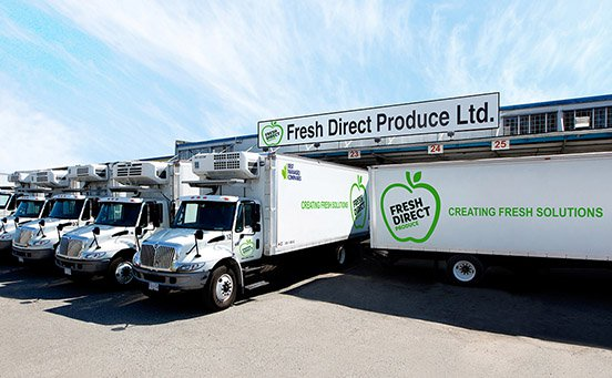 Fresh Direct Produce delivery trucks in loading bays